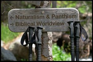 Hiking trail sign with the options of Naturalism and Pantheism or a Biblical worldview. The creation speaks creation ministry