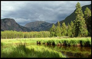 Green mountain pasture and stream in Rocky Mount National Park for solitude of the creation ministry speaking topics